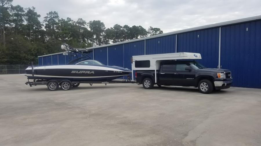 Cabover Camper on half ton truck towing a boat - Boats